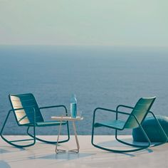 The Copenhagen rocking chair is made from aluminum with all-weather powder coating and is available lava grey or aqua finish. The seat and back is perforated to add transparency and allow water drainage when used outdoors. Modern Outdoor Rocking Chairs, Outdoor Lounge, Outdoor Chairs, Outdoor Living, Outdoor Decor, Outdoor Spaces, Contemporary Dining Chairs, Contemporary Furniture, Traditional Rocking Chairs