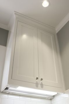 """How to properly light kitchen cabinets.  Keep recessed lights within 18"""" of cabinet front, so the light washes the face.  Use under cabinet lighting for task/accent."""
