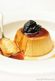Crème caramel and dried prunes cooked in red wine