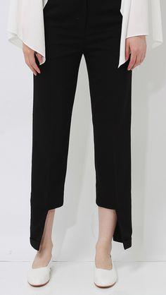 Luna Unbalance Hem Trousers in Black.