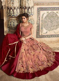 Peach And Red Embellished Lehenga/Pant Suit is especially crafted for showcasing glamorous style and ethnic elegance with its unique embroidered combination of zari, resham and sequence work annota. Party Wear Indian Dresses, Red Wedding Dresses, Pakistani Dresses, Indian Designer Suits, Designer Gowns, Peach Colour Combinations, Peach Color Dress, Indian Wear, Indian Suits