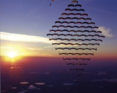 81 skydivers set a new canopy formation world-record over Florida.  {O MY GOSH! neat!}
