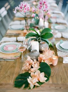 Orchids as centerpieces for Cuban-themed dinner party and colorful table settings to match