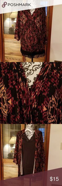 Kimono top EUC. Junarose open front kimono top. Very pretty and looks great with the black tank I have underneath (sold on another listing). Wide 3/4 kimono sleeves and black fringe lines the bottom. Feels wonderful and soft and flowing on and very figure flattering. Size is medium but I wore it even as a 2X. It just kind of adjust with you. Black, peach, rust colored. Junarose Jackets & Coats