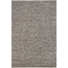 A thick braided pattern highlights this Mandara rug. Handmade in India using New Zealand wool. Area rug features braided pattern in shades of beige and brown.