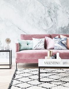 marble wall paper and pink velvet couch