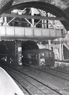 Wapping station with 1938 tube train (unusual for this sub-surface line used by the Overground trains today) Old London, North London, East London, London Underground Tube, London Underground Stations, London Transport, Public Transport, Tube Train, Routemaster