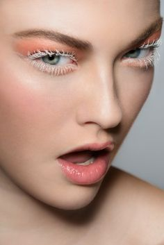 Pink lids, white lashes