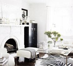 not quite my style, but I'm keeping my color palette to a minimum. greys, whites, and black, with a pop of luxe navy and olive.   Height of cabinet next to fireplace Black & white, Cowhide Rug