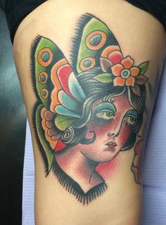 Butterfly/woman head tattoo, American Traditional, bright and bold tattoo by Scott Updike @ Charmed Life Tattoo in Lexington, Kentucky