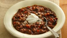 Add something flavorful to your Mexican slow-cooked dinner tonight! Serve this mole chili packed with turkey, Muir Glen® tomatoes, Yoplait® yogurt and Progresso® black beans and chicken broth.