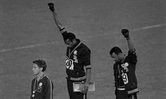 Tommie Smith and John Carlos give the Black Power salute at the 1968 Olympics. As they walked from the arena, after taking a gold medal and a bronze medal for the U.S., many Americans booed them