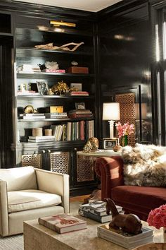 black lacquer bookcases in traditional study den