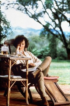 Out of Africa....love the bamboo table and the cane chaise.....