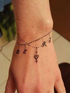 Palm Tattoos, Anklet Tattoos, Tattoo Bracelet, Love Tattoos, Picture Tattoos, Body Art Tattoos, Tatoos, Kids Initial Tattoos, Wrap Around Wrist Tattoos