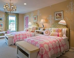 Pretty pink twin beds.