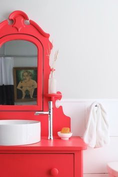 The vintage dresser was painted by Roger and altered by Chris with a Kohler sink and faucet Roger & Chris' Bold, Eclectic & Vivacious 160-Year-Old Victorian