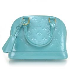 This is an authentic LOUIS VUITTON Vernis Alma BB w Strap in Bleu Lagon.   This is a chic small Alma that is finely crafted of Louis Vuitton monogram embossed vernis patent leather.