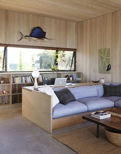 """Tamarkin calls the built-ins he designed """"elegant camp furniture."""" They're all made of inch-thick fir plywood, including the living room's platform sofa."""
