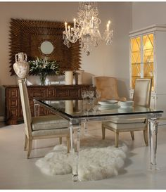 Lucite table base with, I believe, a mirrored top. Wow!