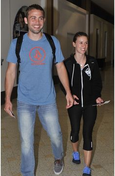 Arriving in Sydney, Australia 4/11/15 with his supportive  partner, Cody's girlfriend, Felicia, has been by his side as he has coped with Paul's death.
