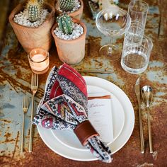 This tablescape is both rustic and elegant. For texture, consider a unique tabletop or linen, pair it with a few potted cacti and bold napkin! Fortessa's tableware, silverware and glassware add an element of understated elegance. Pic by Christina McNeill + styling by Jesse Tombs fro Alison Events