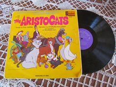 The Aristocats Walt Disney Studio childrens Vintage Vinyl Record Album and Book Sterling Holloway 1970s Cartoon. $15.00, via Etsy.