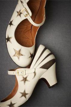 "Stratosphere Mary Janes  Shooting stars stream past the heel and swooping vamp of Chie Mihara's comfort-footbed heels. Buckle closure. Leather and suede upper; leather sole. 2.5"" leather wrapped heel. Handmade in Spain."