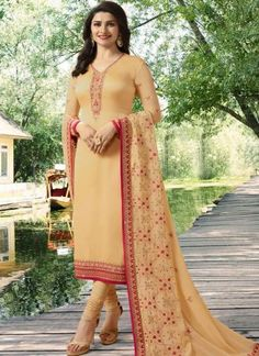 Prachi desai peach embroidered straight cut suit online which is crafted from satin georgette fabric with exclusive embroidery and stone work. This stunning designer straight cut suit comes with santoon bottom and georgette dupatta. Churidar Suits, Patiala, Eid Dresses, Satin Dresses, Indian Dresses, Indiana, Wedding Salwar Suits, Wedding Suits, Prachi Desai