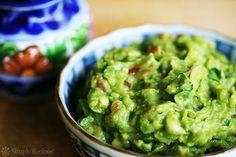 The BEST guacamole! So EASY to make with ripe avocados, salt, serrano chiles, cilantro and lime. On SimplyRecipes.com