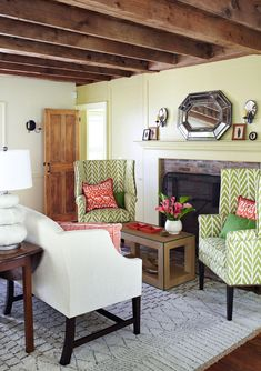 """""""Chimney Wing"""" chairs upholstered in a green-and-white fabric coordinate with the pale green wall of the sitting room. - Traditional Home ®/ Photo: Werner Straube"""