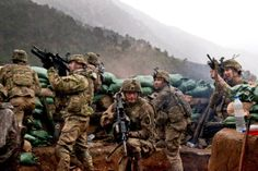 U.S. Soldiers with 2nd Battalion, 327th Infantry Regiment, 101st Airborne Division return fire during a firefight with Taliban forces in Barawala Kalay Valley in Kunar province, Afghanistan, March 31, 2011. U.S. Army photo by Pfc. Cameron Boyd/Released