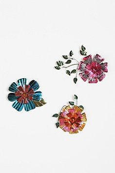 "floral wall sculptures... part of Urban Outfitter's ""Decorate for under 50 Dollars"" deal. $34.00"