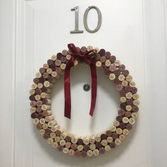 : I work at a winery and am always looking to recycle our used wine corks. I handmade this wreath using natural used wine corks. The corks vary in size and color due to their time in the bottle with white, rose and red wines. Wine corks may vary from J Craft, Wine Craft, Wine Cork Crafts, Wine Bottle Crafts, Wine Bottles, Wine Cork Wreath, Wine Cork Art, Wine Corks, Pinterest Christmas Crafts