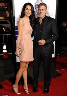 In the spotlight: George didn't seem to mind stunning wife Amal stealing some of the spotlight as they attended the Our Brand Is Crisis premiere