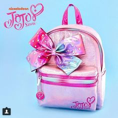 Get sassy school style like Jojo Siwa with this backrom her collection. The pink backpack has a shimmery finish and embellished with a large bedazzled ombre bow. It features a front zipper pocket for extra storage. Jojo Siwa Bows, Jojo Bows, Jojo Juice, Justice Backpacks, Jojo Siwa Outfits, Jojo Siwa Birthday, Mini Mochila, Back Bag, Cute Backpacks