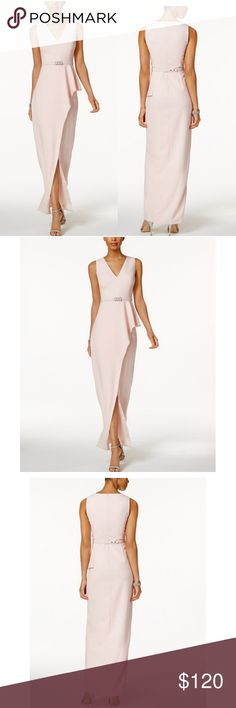 """VINCE CAMUTO BELTED ASYMMETRICAL GOWN A Removable, rhinestone embellished belt adds old Hollywood appeal to this sleek Vince camuto. Flounce at the waist, , the column silhouett drift in an Asymmetrical layerd design that form a haute center slit. . Hidden back zipper closures. . Floor length. . V-neckline :column silhouett. . Asymmetrical layer at skirt with slit at front. . Removable rhinestone embellished belt at waist. . Polyester /spandex :lining polyester . BUST 38"""" .WAIST 30 """" Vince…"""