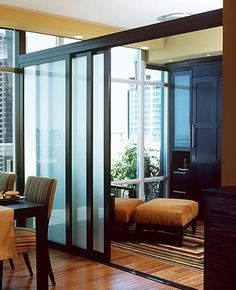 stackable sliding doors to delineate rooms. These frosted glass doors can make the space feel large and open, but can be closed for the room to be used as a guest room. Perfect solution if you own a studio apartment. Indoor Sliding Doors, Sliding Door Room Dividers, Sliding Door Company, Internal Sliding Doors, Room Divider Doors, Room Divider Screen, Glass Partition Wall, Glass Room Divider, Frosted Glass Door