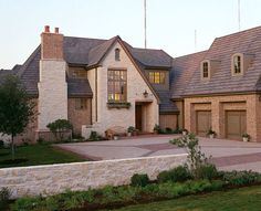 Love this exterior with the fireplace and sloped rooflines