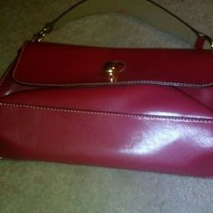 Red leather purse missing part to snap purse Nice leather red purse missing  small piece to close bag but it still closes Small marker stain on handle Bags