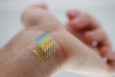 An ultrathin device for mapping changes in skin temperature to 0.02 �C is shown with a representative colormap of temperature distribution on the wrist