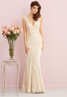 Gorgeous gilded lace covers this elegant, slim-fitting sheath, which is scalloped at the hem, neckline and open back.
