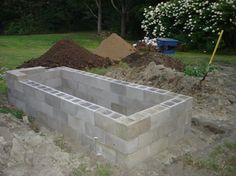 Cinder block raised bed.  Will probably leave the tops open, fill with soil, and plant small plants in them.
