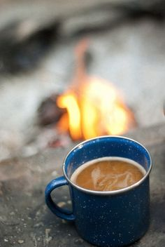 Looking at this image - I can smell the fire, taste the coffee, hear the crackle of the logs and feel the warmth. Everything about this radiates peace and simple happiness.