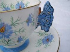 tea cup and saucer blue and gold lotus flower | Aynsley China Butterfly Handle Tea Cup & saucer Light Blue Flowers