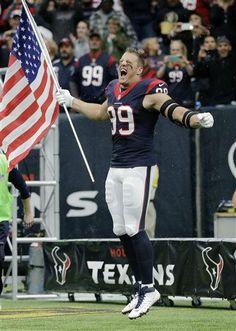 Houston Texans defensive end J.J. Watt carries a United States flag onto the field (AP Photo; David J. Phillip)