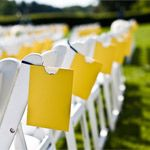 The tri-fold programs were displayed on the back of each ceremony chair in a bright yellow sleeve for a clever burst of color.