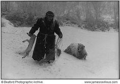 Ivor Brock rescuing a lamb in a blizzard, Millhams, Dolton, Devon, England, 1978 James ravillious