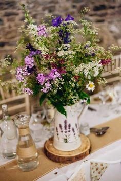 Pitcher Jug Filled with Wild Flowers | Table Centrepiece | New House Farm | Maggie Sottero Shayla Wedding Dress | Rustic Wedding | DIY Decor | Wild Flowers | Sarah Beth Photo | http://www.rockmywedding.co.uk/victoria-michael/