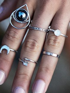 all lovely rings in this photo but the 'I Love You To The Moon & Back Ring' is particularly pretty. So sweet.